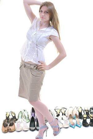 high heels shoes: woman buy shoes concept of choice and shopping, isolated on white background in studio