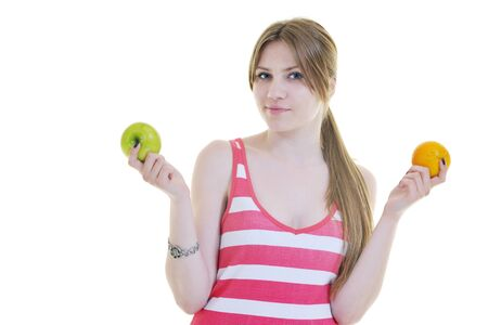 woman eat green apple isolated  on white backround in studio representing healthy lifestile and eco food concept photo