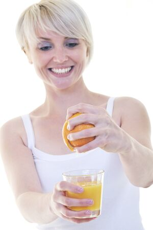 squeeze: woman squeeze fresh orange juice drink  isolated over white background