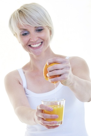 woman squeeze fresh orange juice drink  isolated over white background photo