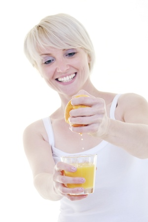 woman squeeze fresh orange juice drink  isolated over white background Stock Photo - 10244678