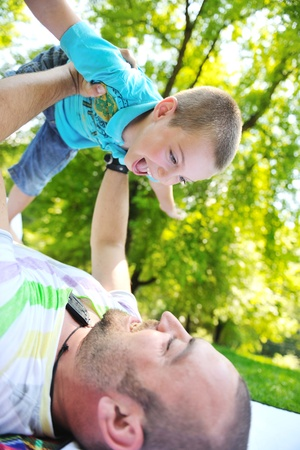 families together: family father and son have fun at park on summer season and representing happines concept