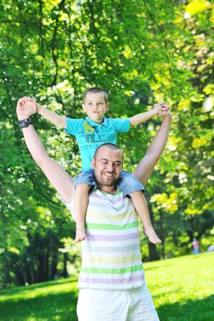 family father and son have fun at park on summer season and representing happines concept Stock Photo - 10492213