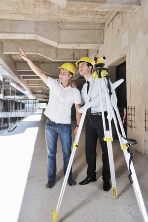 Team of business people in group, architect and engeneer  on construciton site check documents and business workflow on new building Stock Photo - 10540727