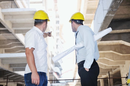 Team of business people in group, architect and engeneer  on construciton site check documents and business workflow on new building Stock Photo - 10540599