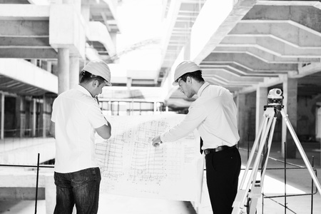 Team of business people in group, architect and engeneer  on construciton site check documents and business workflow on new building Stock Photo - 10540644