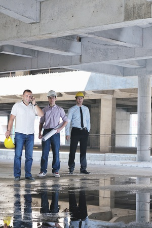 Team of business people in group, architect and engeneer  on construciton site check documents and business workflow on new building Stock Photo - 10546674