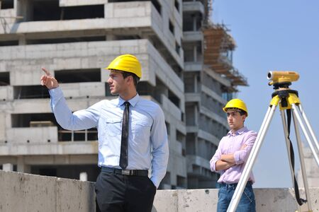 Team of architects people in group  on construciton site check documents and business workflow Stock Photo - 10546630