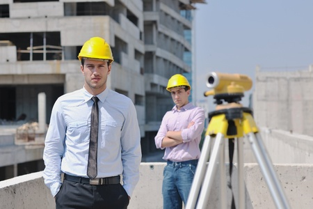 Team of architects people in group  on construciton site check documents and business workflow Stock Photo - 10546626