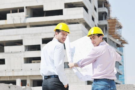 group plan: Team of architects people in group  on construciton site check documents and business workflow Stock Photo