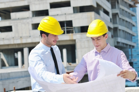 site manager: Team of architects people in group  on construciton site check documents and business workflow Stock Photo