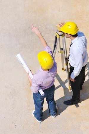 Team of architects people in group  on construciton site check documents and business workflow Stock Photo - 10515538