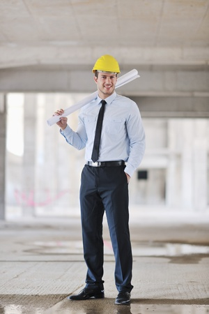 architect plans: Construction Project business man Architect engineer manager at construction site