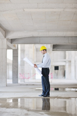 construction site helmet: Construction Project business man Architect engineer manager at construction site