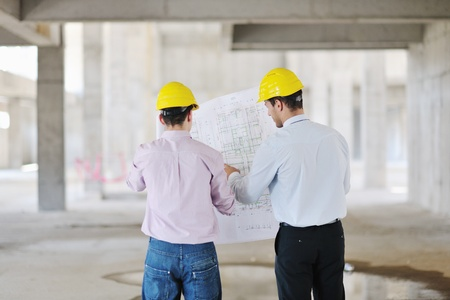 Team of architects people in group  on construciton site check documents and business workflow Stock Photo - 10540868