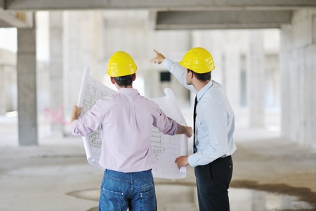 Team of architects people in group  on construciton site check documents and business workflow Stock Photo - 10540878