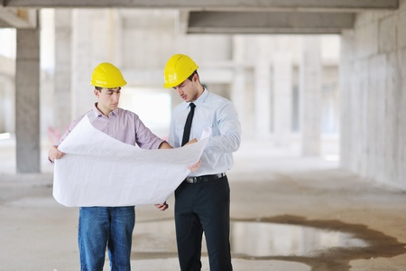 Team of architects people in group  on construciton site check documents and business workflow Stock Photo - 10540861