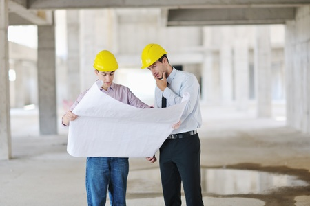 Team of architects people in group  on construciton site check documents and business workflow Stock Photo - 10540672