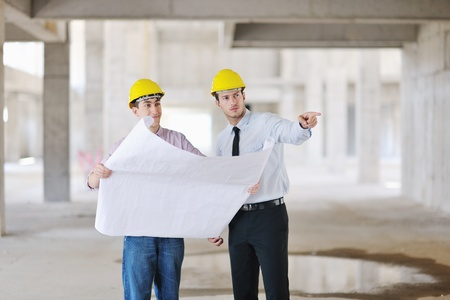 Team of architects people in group  on construciton site check documents and business workflow Stock Photo - 10540676