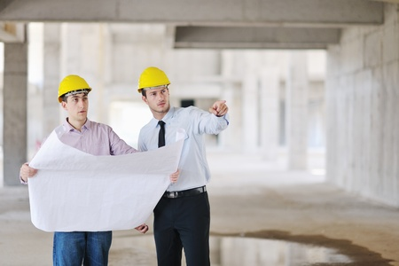 construction workers: Team of architects people in group  on construciton site check documents and business workflow Stock Photo