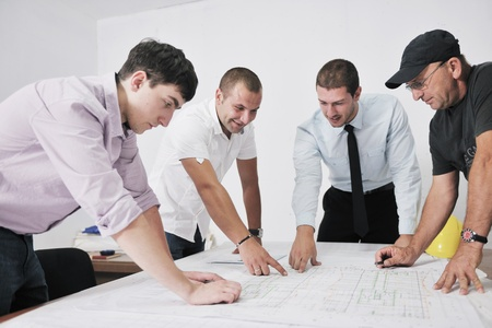 architect office: Team of architects people in group  on construciton site check documents and business workflow Stock Photo