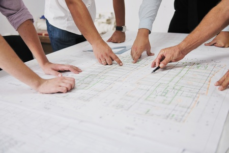 architect plans: Team of architects people in group  on construciton site check documents and business workflow Stock Photo