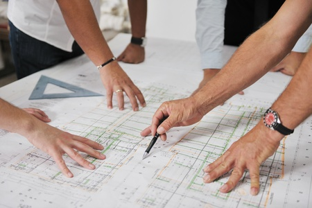 construction sites: Team of architects people in group  on construciton site check documents and business workflow Stock Photo