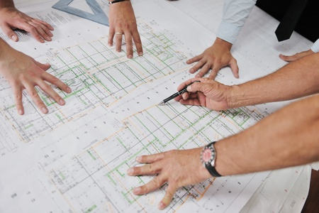 project manager: Team of architects people in group  on construciton site check documents and business workflow Stock Photo