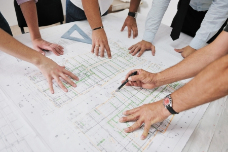 business project: Team of architects people in group  on construciton site check documents and business workflow Stock Photo