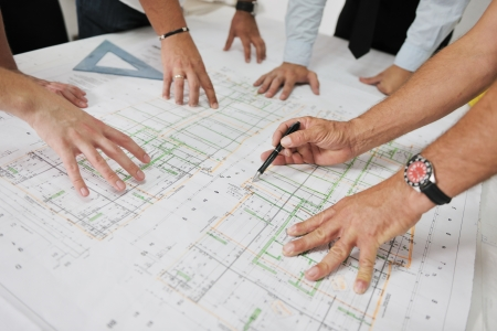 building blueprint: Team of architects people in group  on construciton site check documents and business workflow Stock Photo