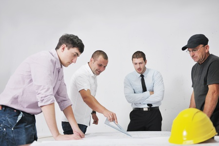 Team of architects people in group  on construciton site check documents and business workflow Stock Photo - 10540671