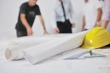 building plan: Team of architects people in group  on construciton site check documents and business workflow Stock Photo