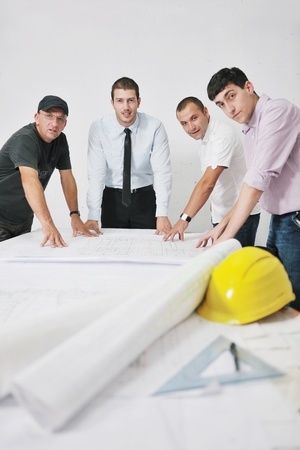 Team of architects people in group  on construciton site check documents and business workflow Stock Photo - 10540867