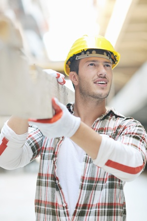 repairmen: handsome hard worker people portrait at concstruction site Stock Photo
