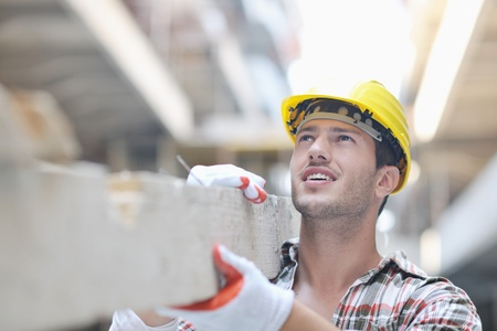brick work: handsome hard worker people portrait at concstruction site Stock Photo