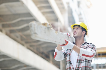 hard worker: handsome hard worker people portrait at concstruction site Stock Photo