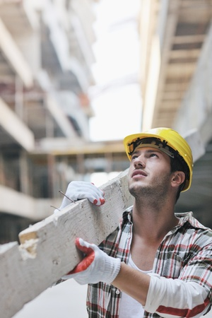 laborers: handsome hard worker people portrait at concstruction site Stock Photo