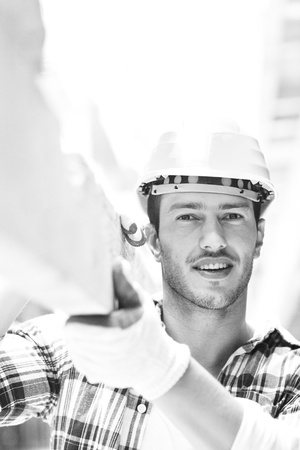 handsome hard worker people portrait at concstruction site Stock Photo - 10540732