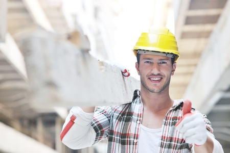 handsome hard worker people portrait at concstuction site Stock Photo
