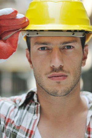 foreman industrial: handsome hard worker people portrait at concstruction site Stock Photo