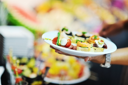 breakfast hotel: womanl chooses tasty meal in buffet at hotel  banquet party restaurant Stock Photo
