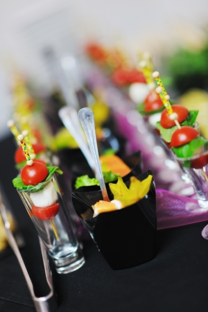 buffed food closeup of  fruits, vegetables, meat and fish arranged on banquet table photo