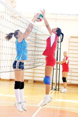 volleyball game sport with group of young beautiful  girls indoor in sport arena Stock Photo - 10650178
