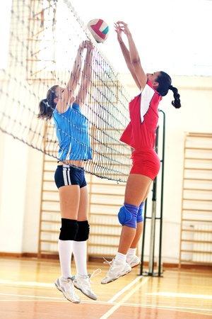 volleyball game sport with group of young beautiful  girls indoor in sport arena Stock Photo - 10650243
