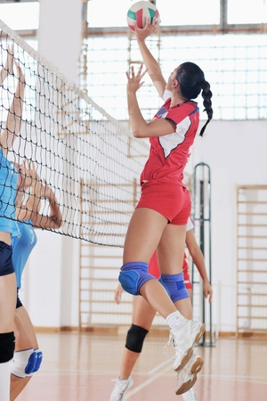 volley ball: volleyball game sport with group of young beautiful  girls indoor in sport arena Editorial