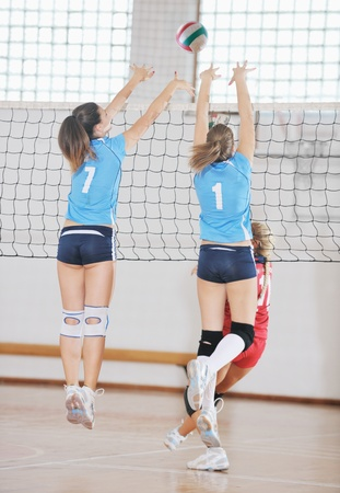volleyball game sport with group of young beautiful  girls indoor in sport arena Stock Photo - 10650176