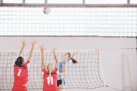 volleyball game sport with group of young beautiful  girls indoor in sport arena Stock Photo - 10654017