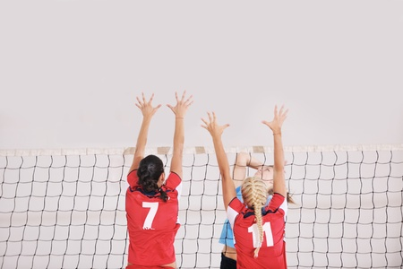 volleyball game sport with group of young beautiful  girls indoor in sport arena Stock Photo - 10654039