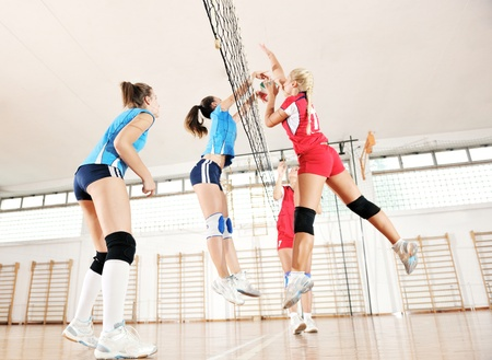 volleyball game sport with group of young beautiful  girls indoor in sport arena Stock Photo - 10650171