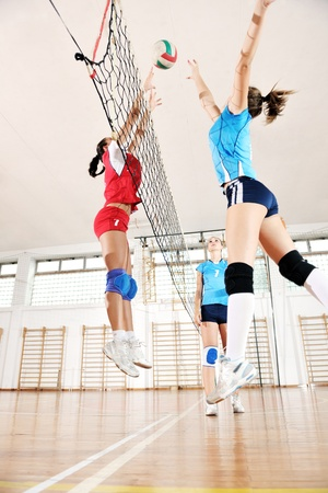 volleyball game sport with group of young beautiful  girls indoor in sport arena Stock Photo - 10650134